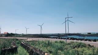 Jeju beach with windmill coastal road
