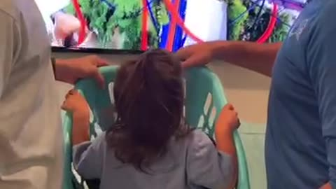 Dad And Uncle Take Toddler On Roller Coaster Experience In Laundry Basket