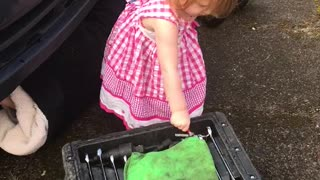 Daughter Helps Daddy with Car Maintenance