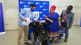Nomaxhabiso Nobaza with his son Phaphamani Gotsi getting Tittle deed