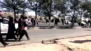 Afghans walk to Kabul airport, after Taliban takes control