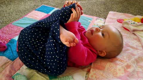 Baby tries to eat her own toe