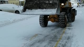 Snow cleaning on the street in winter.