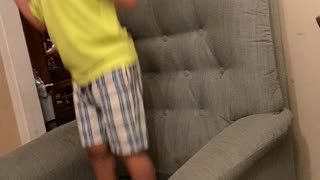 Boy like jumping on the sofa