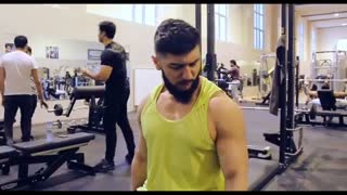 gigantic man doing sport at gym hall