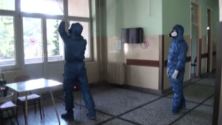 Russia Experts In PPE Disinfect Serbia Hospitals