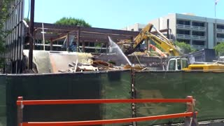 A Building being Demolished by Excavator Arm