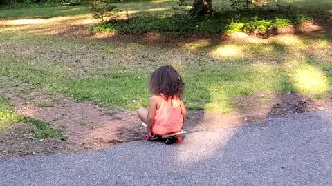 Child riding skateboard