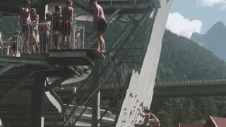 Black shorts guy back flip belly flop water park