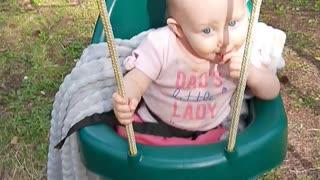 Sweet baby on swing