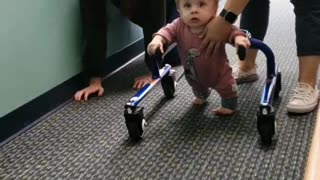 Precious little boy with dwarfism learns how to walk