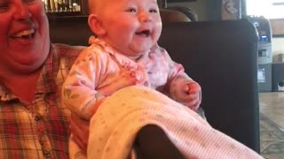 Adorable baby can't stop laughing for her FIRST TIME!