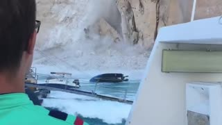 Cliff collapses on Greek beach, injures tourists