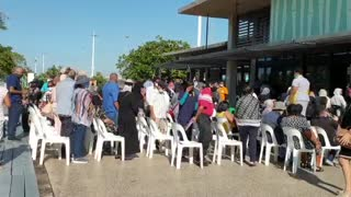 Elderly and health workers follow vaccination queue