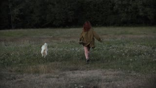 Woman Playing with Her Dog