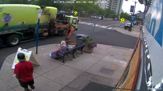 Woman Thrown To The Ground After Garbage Truck Hits Bench