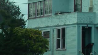 Man Practices Karate on a Roof