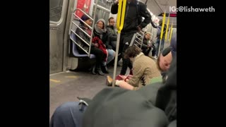 Subway train with guy slumped over sleeping, woman on the floor, guy trips and falls