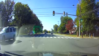 Near Miss With Motorcycle as Pickup Runs Red Light