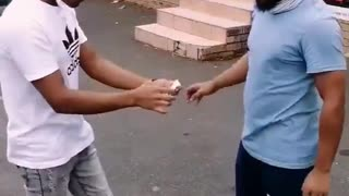 Slapping people and give them money by some one