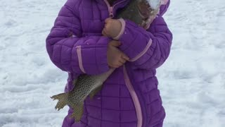 Daughter's First Fish Through the Ice