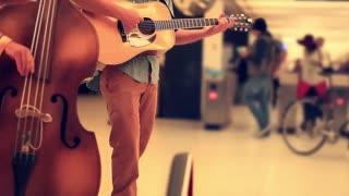 Playing Guitar In Subway