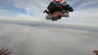Skydiving through clouds
