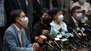 Hong Kong's pro-democracy lawmakers take part in a mass resignation