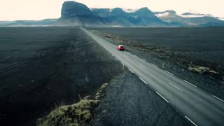Car Driving Through Icelandic Landscape