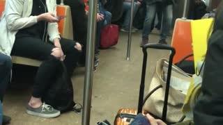 "Man sings ""lean on me"" loudly on subway train"
