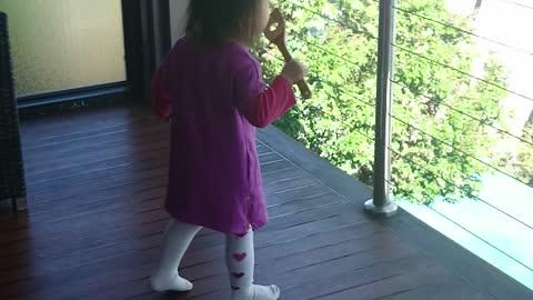 Precious toddler pretends to blow bubbles