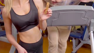 funny video of man and woman in a gym