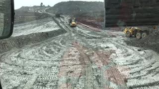 Dump Truck Drifting in to Be Loaded