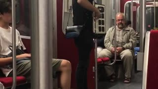 Guy playing accordion subway black clothes white shoes