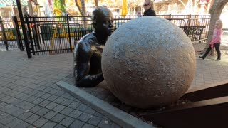 Strange Art ~ Man Rolling Ball