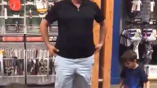 Dad wearing rollerskates falls on floor after daughter tickles him