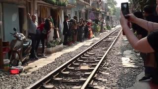 Train Passes Through Tiny Street in Vietnam