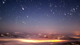 Impressive meteor shower seen from a mountain