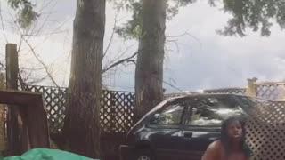 Woman dancing outside on driveway falls on platform