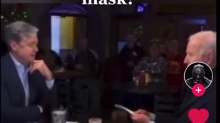 Joe Biden wearing a mask exposed