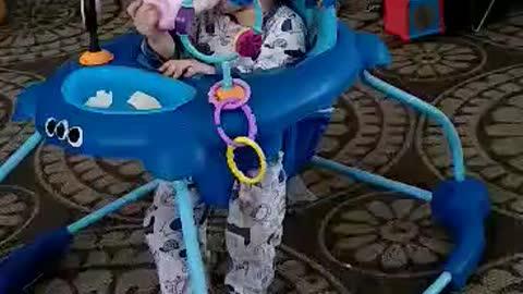 Cute baby falls asleep sitting up