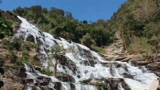 Rocky waterfalls with trees around it