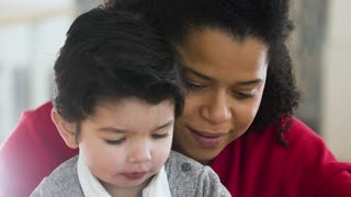 Video of a Woman Holding a Boy