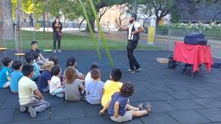 Children watching free performances at the playground