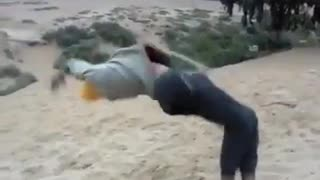 Guy yellow beanie backflip fail sand