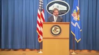 DOJ Official Puts On Mask Just The Walk To The Podium | The Washington Pundit
