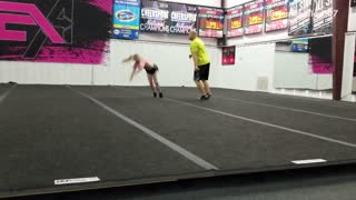 Girl does gymnastic move on platform and lands on head