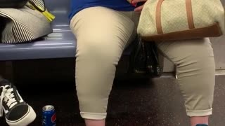Woman dozes off and falls asleep while eating cheez its on subway