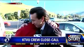 Reporter nearly run over by car