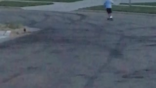 Little boy blue shirt scooter gos too fast and falls off